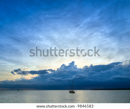 Distant Storm at Sunset - stock photo