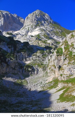 Distant summits on the limestone mountains covered with vegetation - stock photo