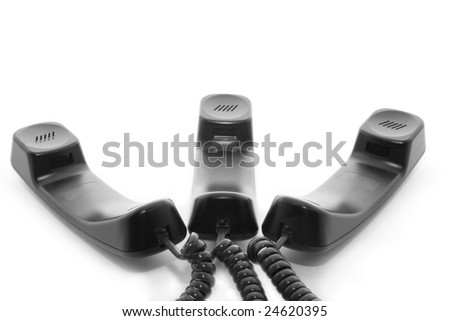 Distant talk on teleconference: group of phone handsets - stock photo