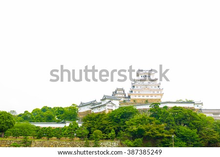 Distant view of front facade of Himeji-jo castle on bright overcast day in Himeji, Japan after 2015 renovations finished. Copy space
