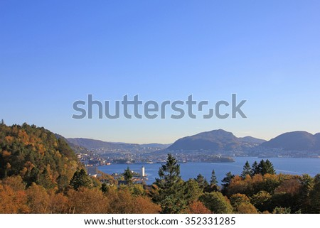 Distant view of harbor city by fall / Autumn view of the entrance to Bergen, Norway. - stock photo