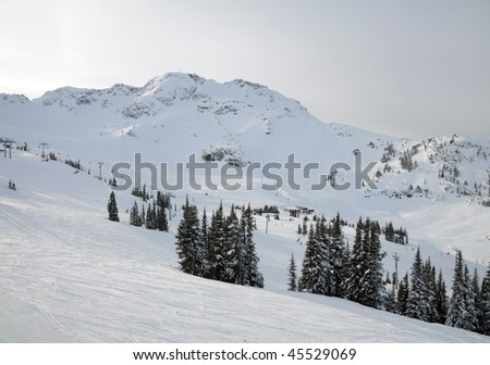 Distant view of one of lift stations at Whistler-Blackcomb ski resort - stock photo