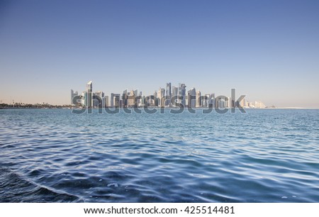 Distant view of West bay Doha, Qatar, in Arabia, shot from the Corniche across the Arabian Gulf.
