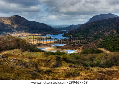 Distant view over lakes and mountains in Ring of Kerry, Ireland - stock photo