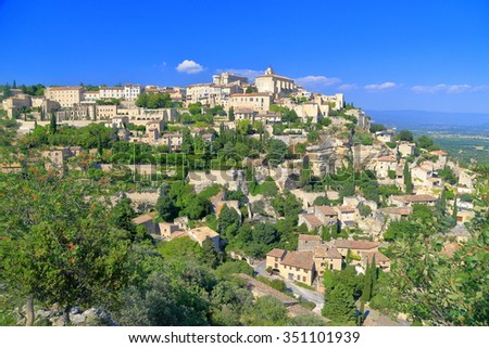 Distant view to historical buildings of the Gordes village in Provence-Alpes-Cote d'Azur, France