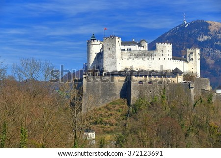 Distant walls of a castle dominating the surroundings in Salzburg, Austria - stock photo