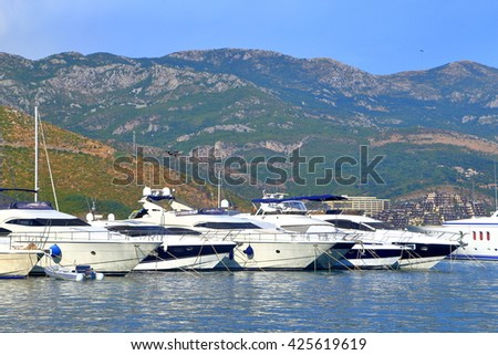 Distant yachts inside Adriatic sea harbor, Budva, Montenegro - stock photo