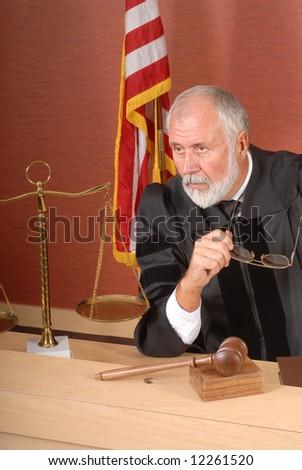 Distinguished older judge making up his mind - stock photo