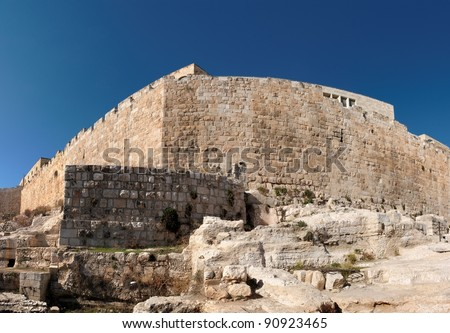 Distorted view of the corner of Jerusalem Old City wall near the Dung gate - stock photo