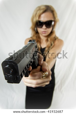 Distorted View on a Beautiful Secret Agent Woman Pointing a Handgun - stock photo