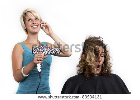 distracted hairdresser - stock photo