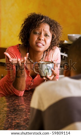 Distraught African-American woman and male have serious discussion - stock photo