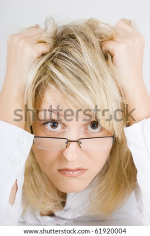 distraught young woman blonde girl with glasses - stock photo
