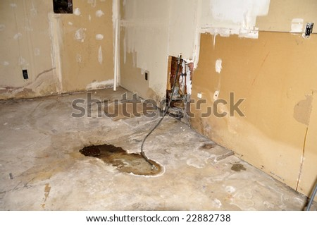 distressed basement wall and floor in an old home - stock photo