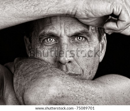 Distressed Man Framing His Face with His Arms - stock photo