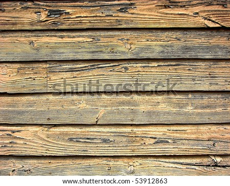 Distressed old barn wood clapboard background on a historic building - stock photo