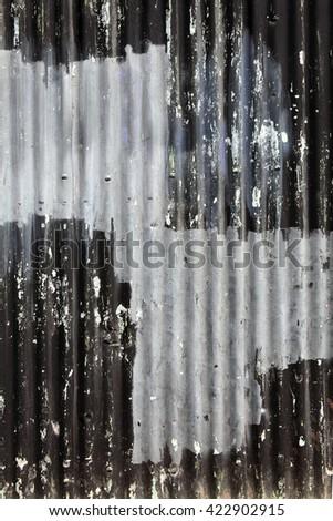Distressed old corrugated iron fence background - stock photo