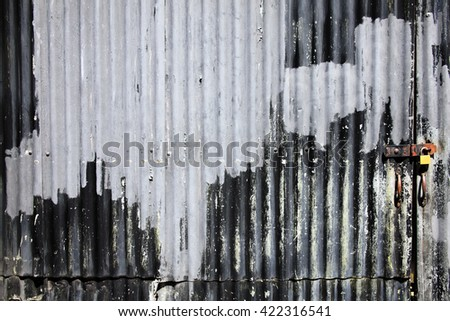 Distressed old corrugated iron fence with a door background - stock photo