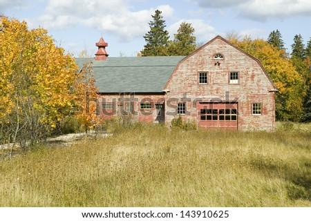 Distressed red barn in autumn, Acadia National Park, Maine - stock photo