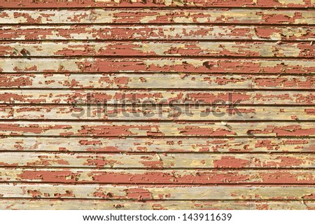 Distressed red barnwood siding in Acadia National Park, Maine - stock photo