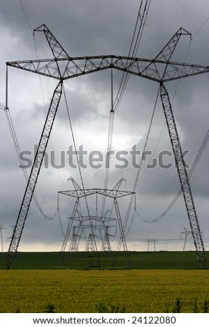 distribution line over stormy sky