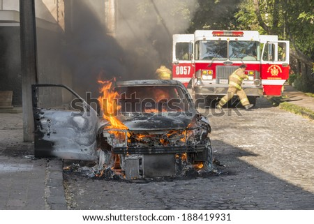 DISTRITO FEDERAL, MEXICO- JANUARY 22: Firemen arrive to help an already burnt car that caught fire due to an electric short circuit. This image taken on January 22, 2014.  - stock photo