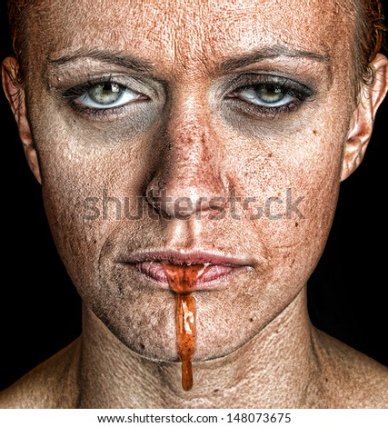 Disturbing Image of a woman with depression with liquid coming from her mouth - stock photo