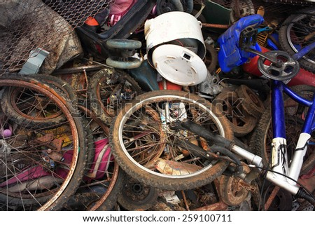 Disused parts of bikes in a heap  junkyard Iron - stock photo
