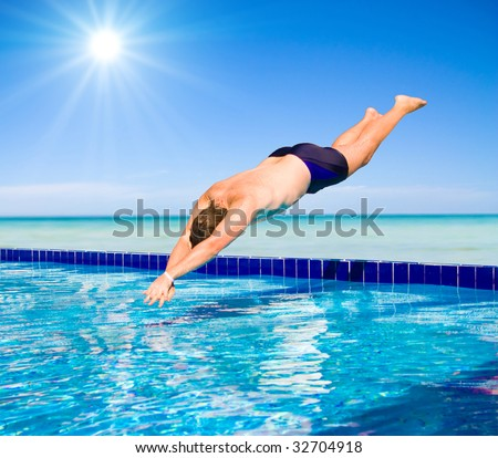 People diving into a pool