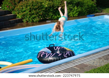 Dive A smart dive into the pool in the garden.  - stock photo