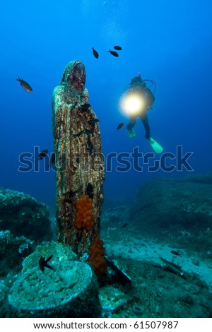 Diver and madonna - stock photo