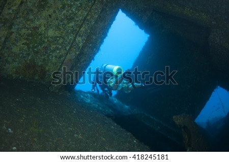 Diver and Marine shipwreck - stock photo