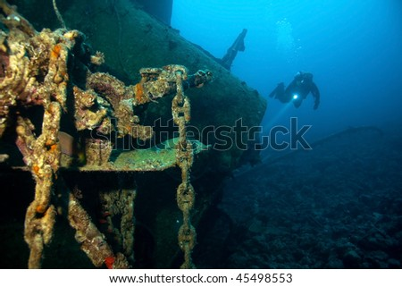Diver and Wreck - stock photo