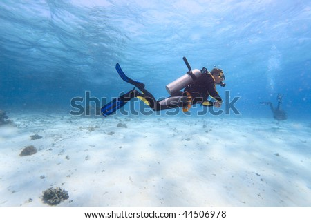 Diver in shallow water - stock photo