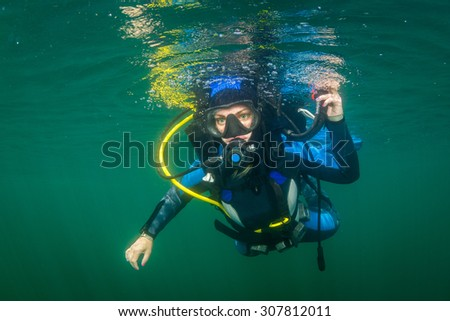 Diver in the bottom of a river - stock photo