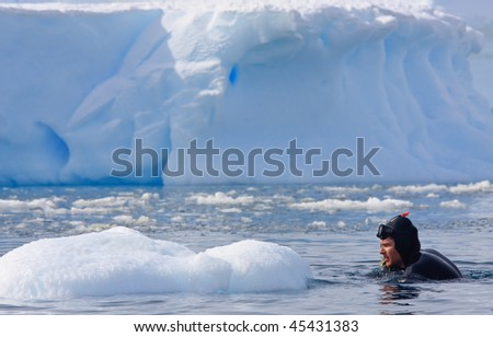Diver on the ice - stock photo