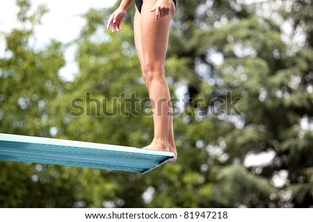Diver on the springboard - stock photo
