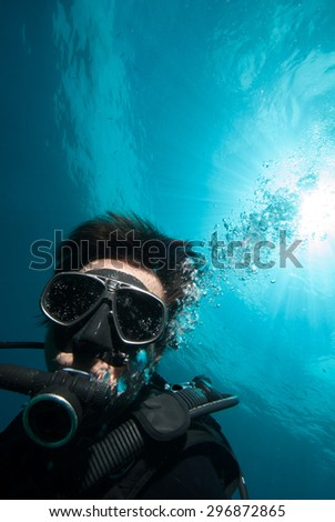 diver scuba diving bunaken indonesia sea reef ocean close up - stock photo