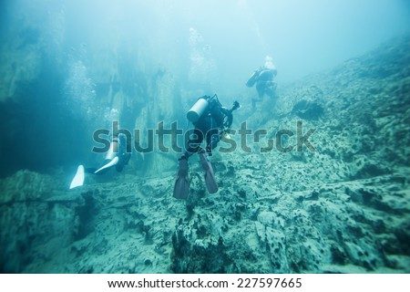 diver underwater. Barracuda Lake, Coron, Philippines. - stock photo
