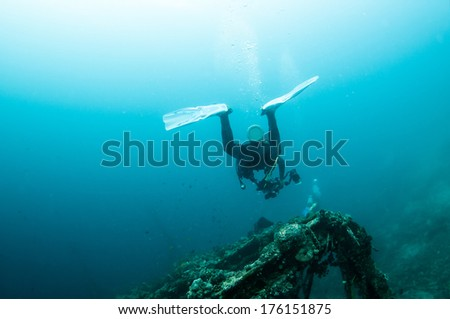 Diver with Marine shipwreck, Anilao, Philippine.