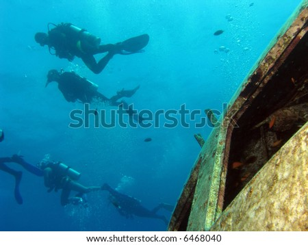 Divers above a shipwreck - stock photo