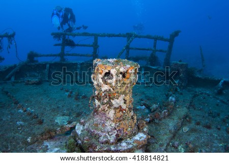 Divers and shipwreck - stock photo