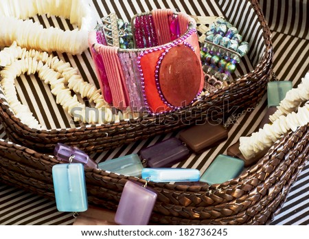 Divers costume jewelry in basket - stock photo