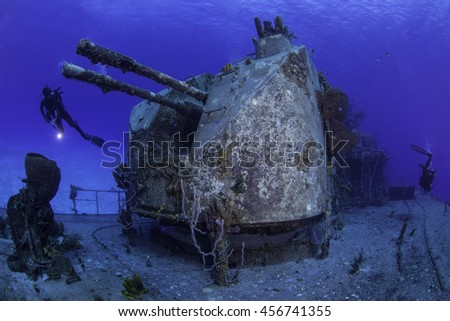 Divers exploring the aft section of the Tibbetts wreck in Cayman Brac - stock photo