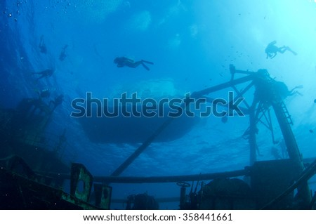 Divers on the surface at the USS Kittiwake - stock photo