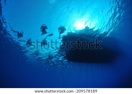 Divers on the surface ready for descent, Grand Cayman - stock photo