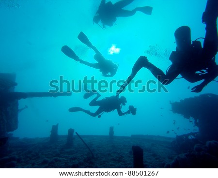 Divers Silhouette On Wreck
