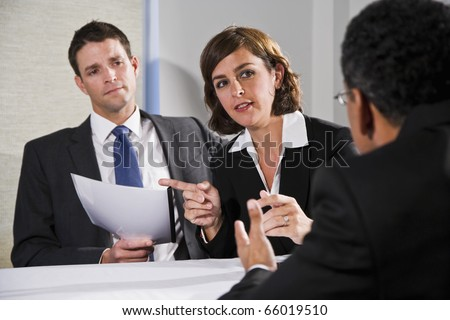 Diverse business people conversing and negotiating, selective focus on businesswoman, 40s - stock photo