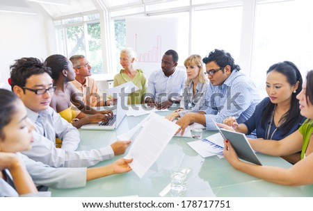 Diverse Business People Working Together in Office - stock photo