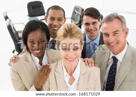 Diverse close business team smiling up at camera in the office - stock photo